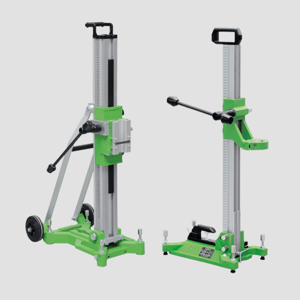 Image of two drill stands of the Master series with variable height, castors for transport and an accident-free stand, combination of green and silver color.