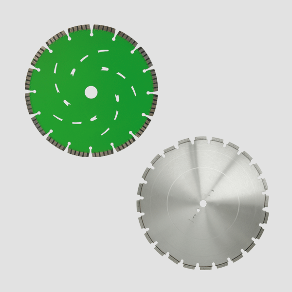 In the upper left corner of this picture there is a green diamond cutting disc, in the lower right corner there is a gray diamond cutting disc.